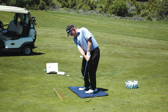 Staying down in the follow through with 74% of weight in the front foot
