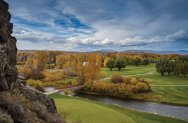 The 13th green at Dos Rios Golf Club squeezes between the Gunnison River and Hartman Rocks.