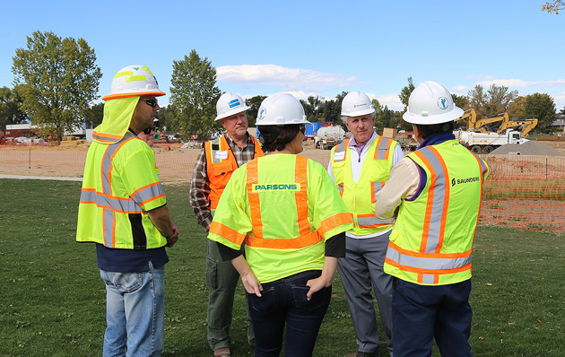 Hale Irwin (second from right) and the program team at the City Park Golf Course in Denver (courtesy of Saunders Construction)