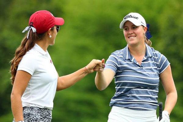 Jennifer Kupcho (left) and Maria Fassi (right) fist bump on their way to the 12th green during the Augusta National Women's Amateur. (photo courtesy of Rob Schumacher, USA Today Sports)