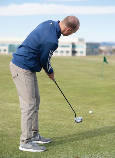 Trent Wearner practicing around the greens