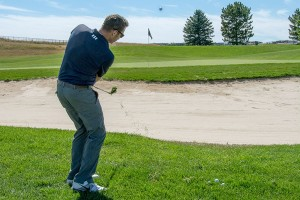 Chipping over the bunker with lob wedge