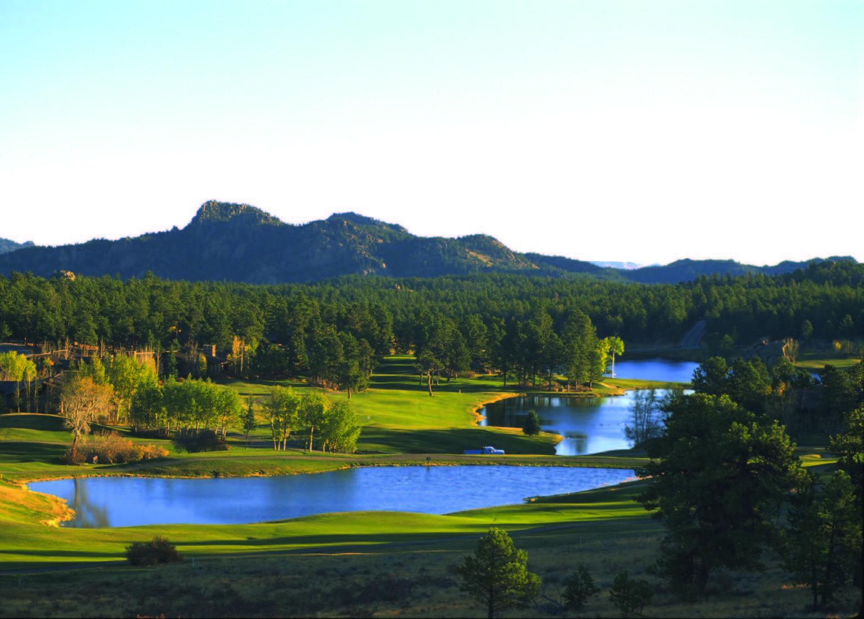 PINING FOR PAR: Ponderosas and lakes Shawnee and Lakota frame Fox Acres' par-5 seventh and par-3 third.