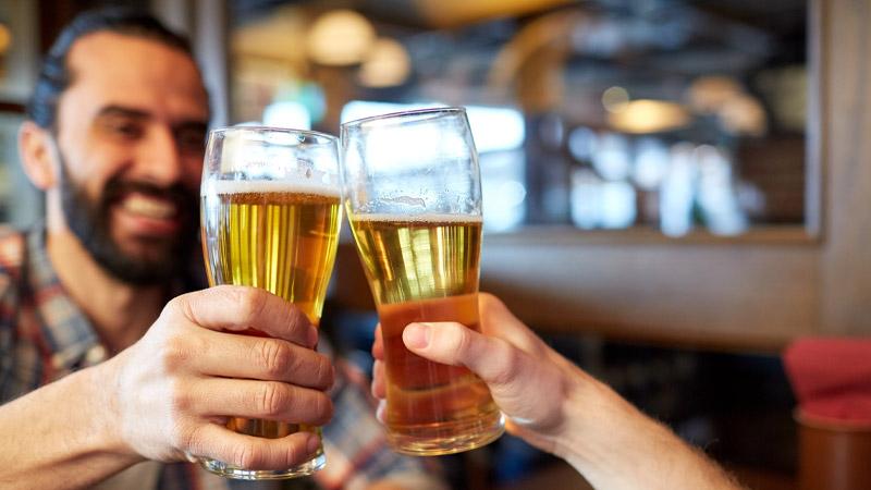 A couple enjoying some beer at Beaver Run Resort.