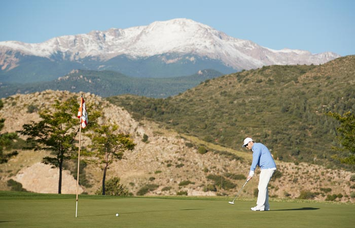 A golfer at Kissing Camels Golf Course - Garden of the Gods Resort & Club