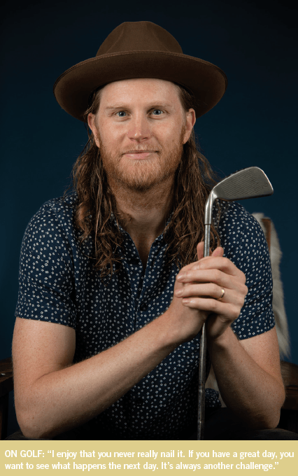 Wesley Schultz of The Lumineers poses with a golf club.