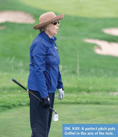 Kay Griffel reacts to a well-hit chip shot at The Ridge at Castle Pines.