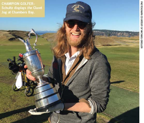 The Lumineer holding the Claret Jug at Chambers Bay.