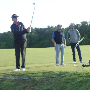 John Purcell with GOLFTEC professionals out on the course.