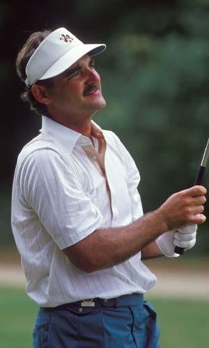 Bill Loeffler eyes a golf shot.