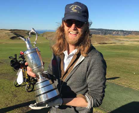 Wesley Shultz of The Lumineers holding the Claret Jug
