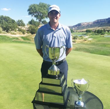 Ben Corfee and the Rocky Mountain Open trophy.