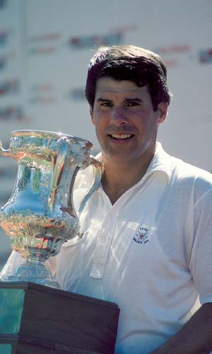 Jay Sigel holding a trophy.