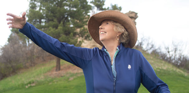 Kay Griffel strikes an opera pose on the golf course.
