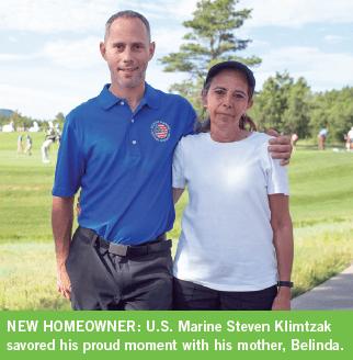 U.S. Marine Steven Klimtzak savored his proud moment with his mother, Belinda.