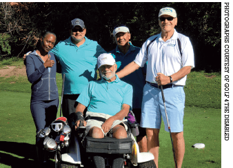 Golf 4 the Disabled participants out on the golf course.