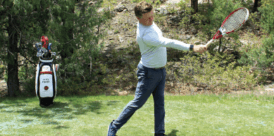 Alex Fisher demonstrates the third phase of a draw technique drill with a tennis racket.