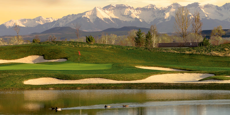 The Bridges Golf Club in Montrose with the San Juan Mountains in the background.