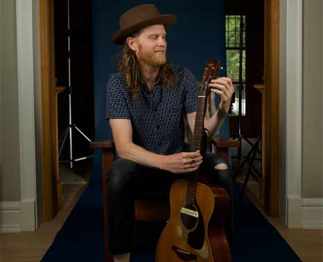 Wesley Shultz of The Lumineers tunes is guitar