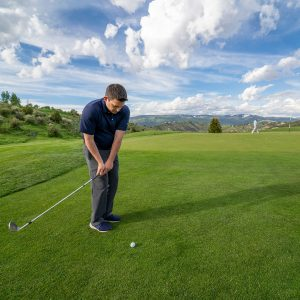 A golfer chips up onto the putting service.