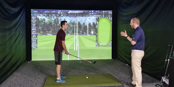 Inside a hitting bay at PGA TOUR Superstore