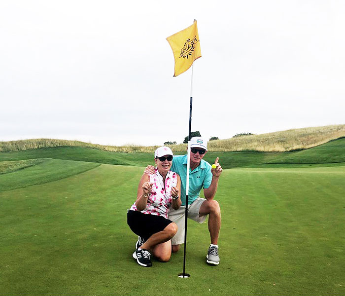Mark Person and Patty Novosel-Person celebrate an ace at the Club at Pradera