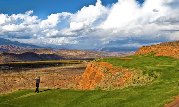 A golfer tees off on Sand Hollow's Championship Course