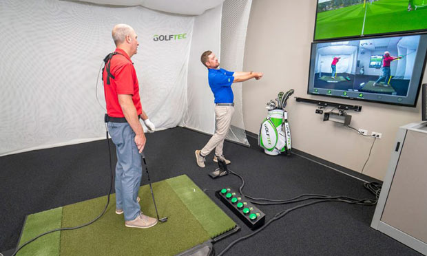 GOLFTEC teacher in a lesson with a student