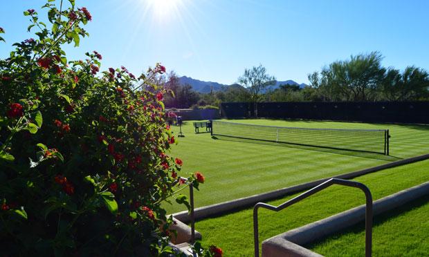 Grass tennis court at Desert Highlands