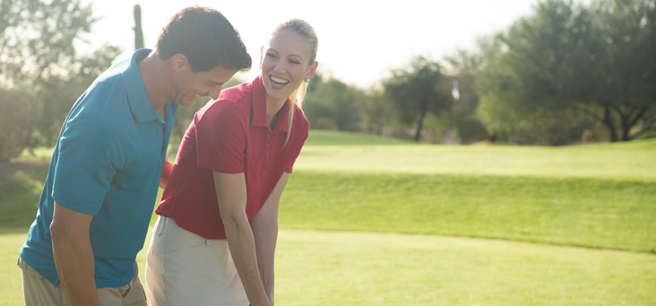 A couple enjoy their time playing golf