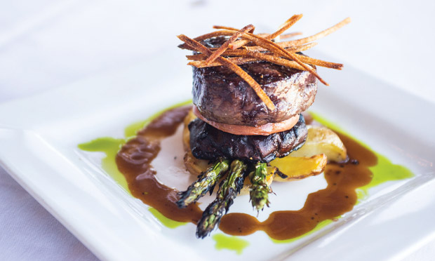 Blackstone's tantalizing tenderloin steak stack with portobello mushrooms and asparagus.