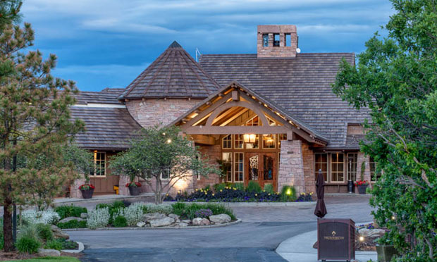 The front of the clubhouse at the Country Club at Castle Pines