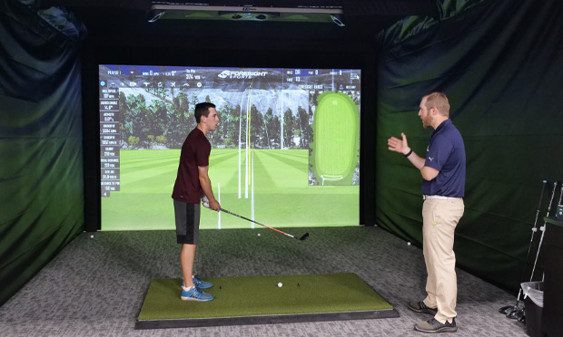 a customer gets a fitted club from a golf equipment professional