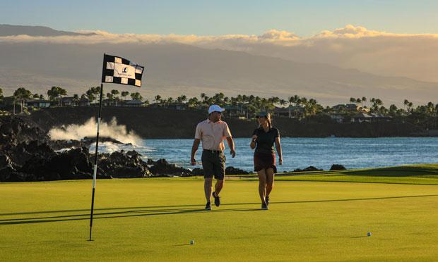Two golfers enjoy their time at Mauna Lani on the big island of Hawai'i
