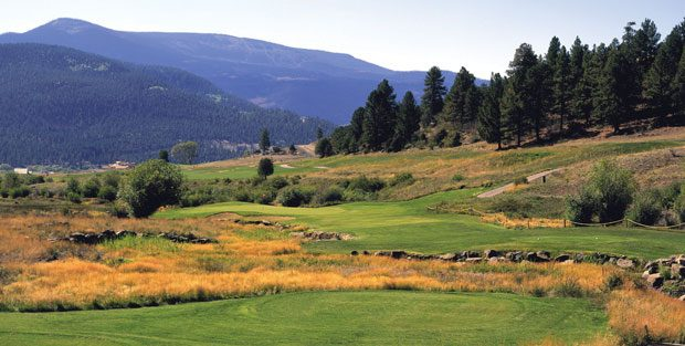 Alder Creek snakes stealthily through the 207-yard par-3 14th at Rio Grande Club.