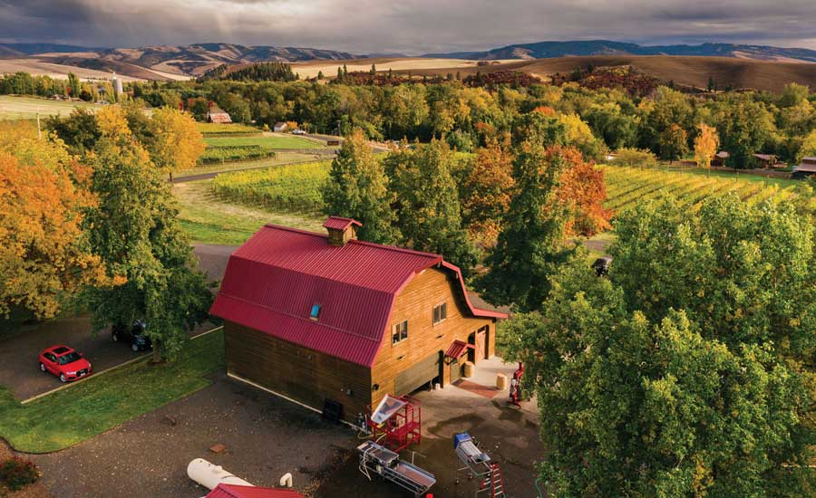 Walla Walla Vintners conducts tastings of its award-winning vintages in its iconic red-roofed barn nestled within the vineyards of Cut Bank Estate.