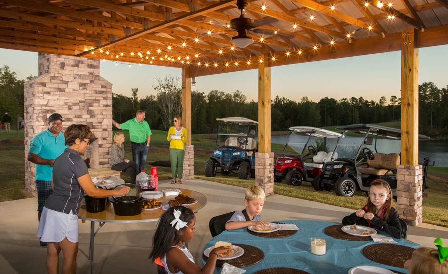 A cookout featuring several Club Car Onward models