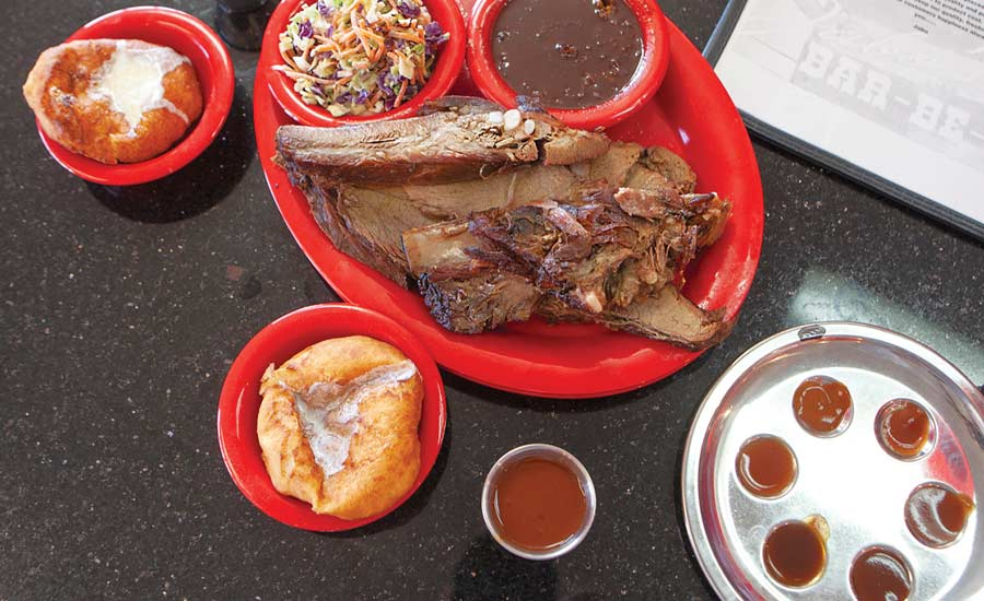 EYE 'CUE: Jabo's rib-sticking Louisiana Bar-Be-Q pairs with its bbq beans and sinful sconuts