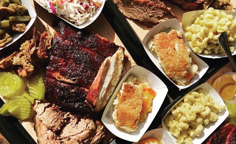 WAYNE'S WORLD: Pounds of assorted bbq deliciousness await at Wayne's Smoke Shack, where St. Louis pork rib, smoked brisket, spice-crusted juicy turkey breast and mountains of sides carry the day.