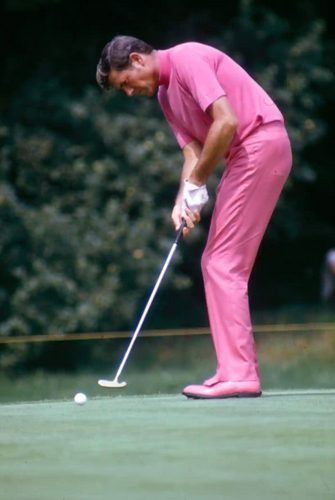 Doug Sanders dressed in an all pink outfit while out on the course.
