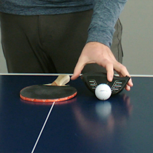Ping Pong Paddle compared with Driver to Show why Slicing Occurs.