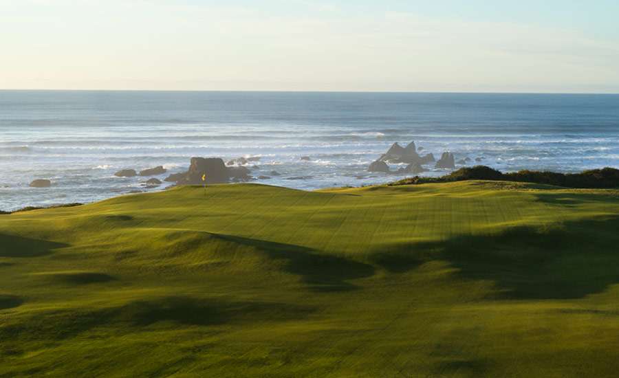 INTO THE WIND: A forgiving emerald expanse awaits on the par-3 fifth.