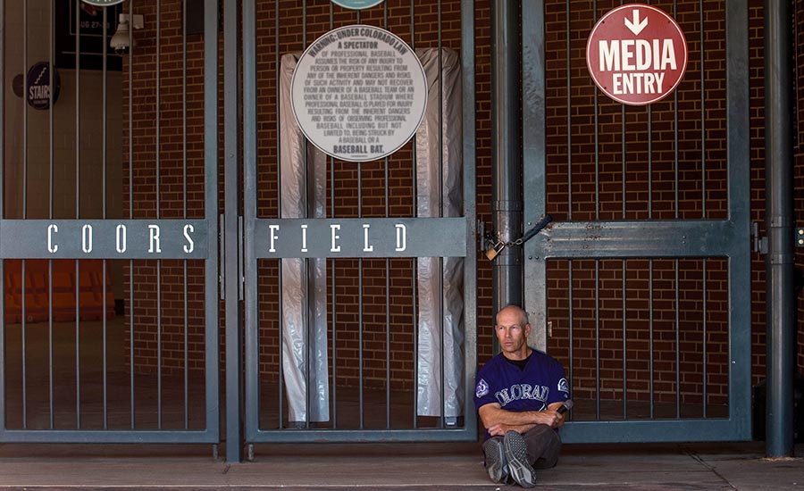 Drew Goodman sitting out from of Coors Field