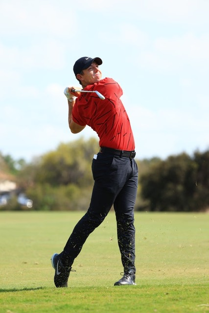 RORY WEARING RED FOR TIGER